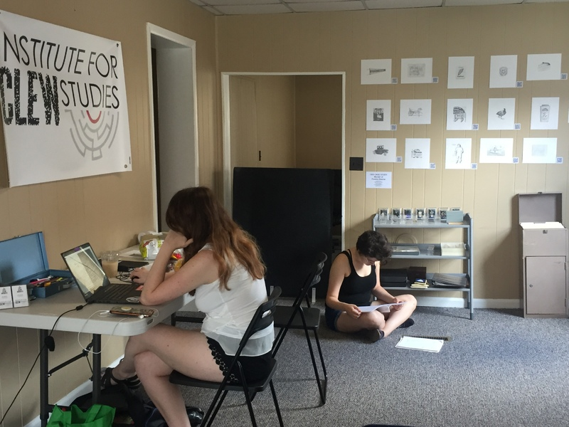 Office, two students working